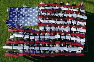 make-a-difference-day-human-flag-2002-faces